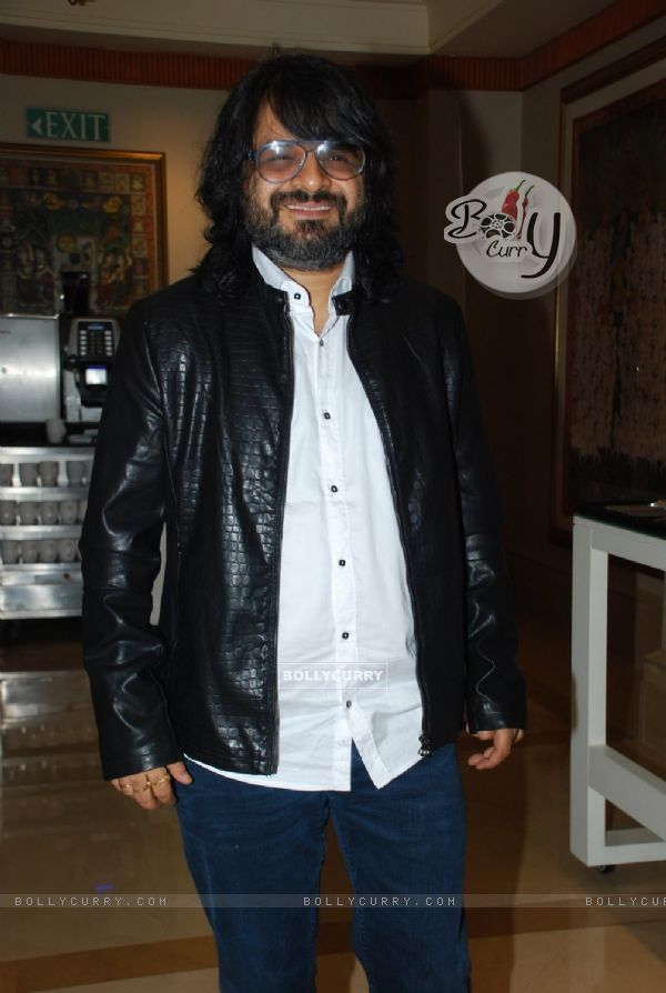 Pritam Chakraborty poses for the media at Radio Mirchi Awards Jury Meet