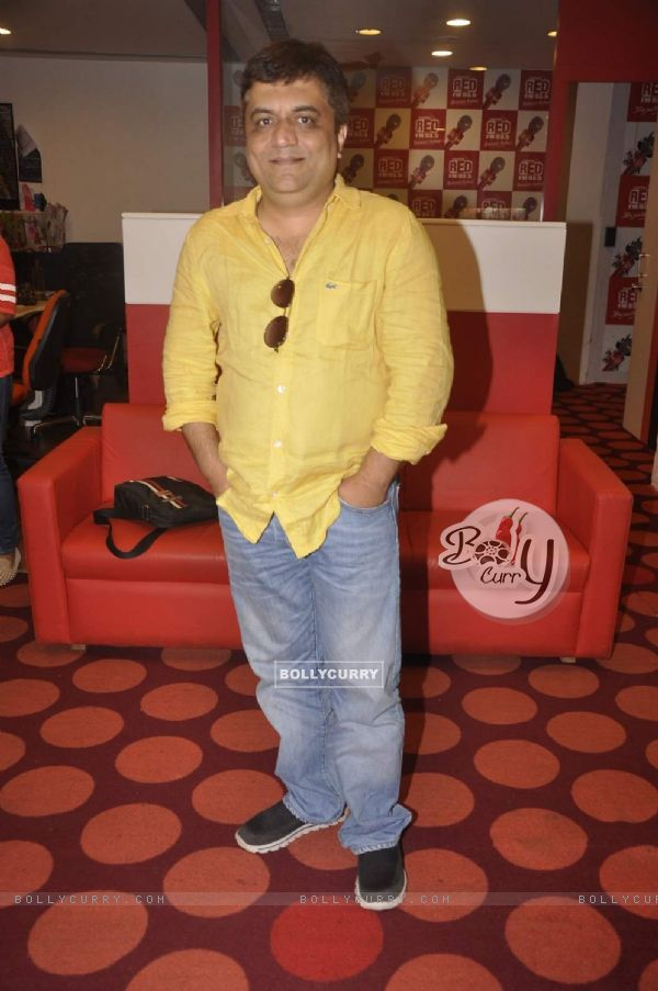 Swanand Kirkire poses for the media at the Promotions of Masaan on Red FM