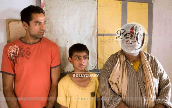 A still image of Abhay Deol and Satish Kaushik