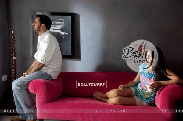 Neha Dhupia and Rajat Kapoor looking tensed