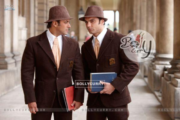 Sohail Khan whispering to Salman Khan