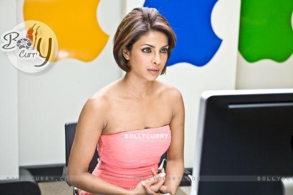 Priyanka Chopra sitting in front of computer