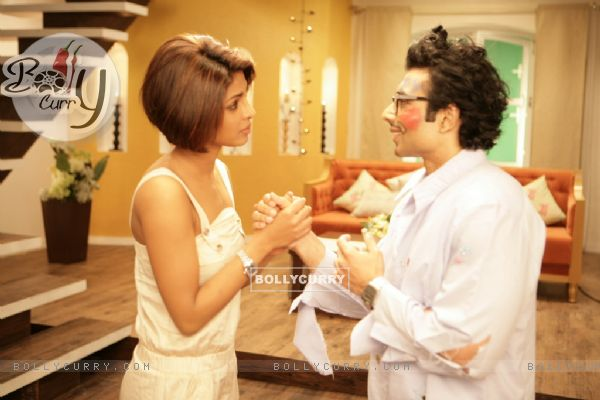 Uday standing with Priyanka Chopra