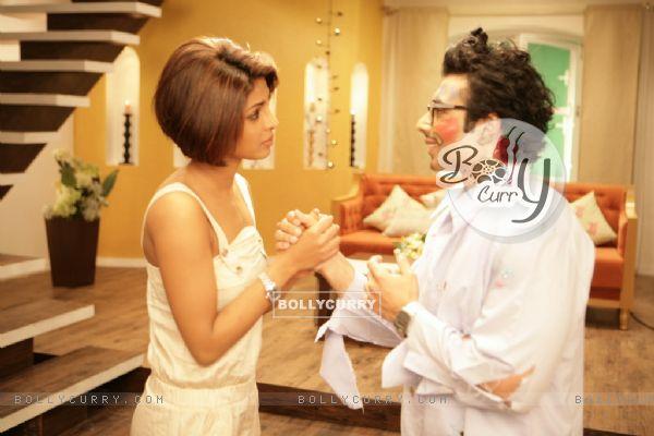 Uday standing with Priyanka Chopra (40390)