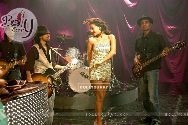 Neha Dhupia dancing on a dance floor (41200)