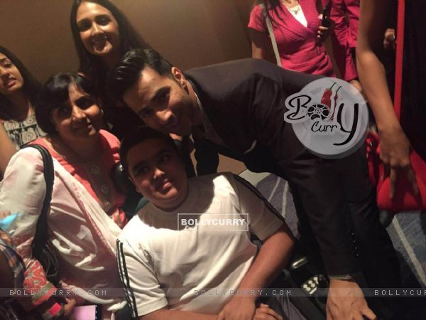 Varun Dhawan takes a picture with a fan