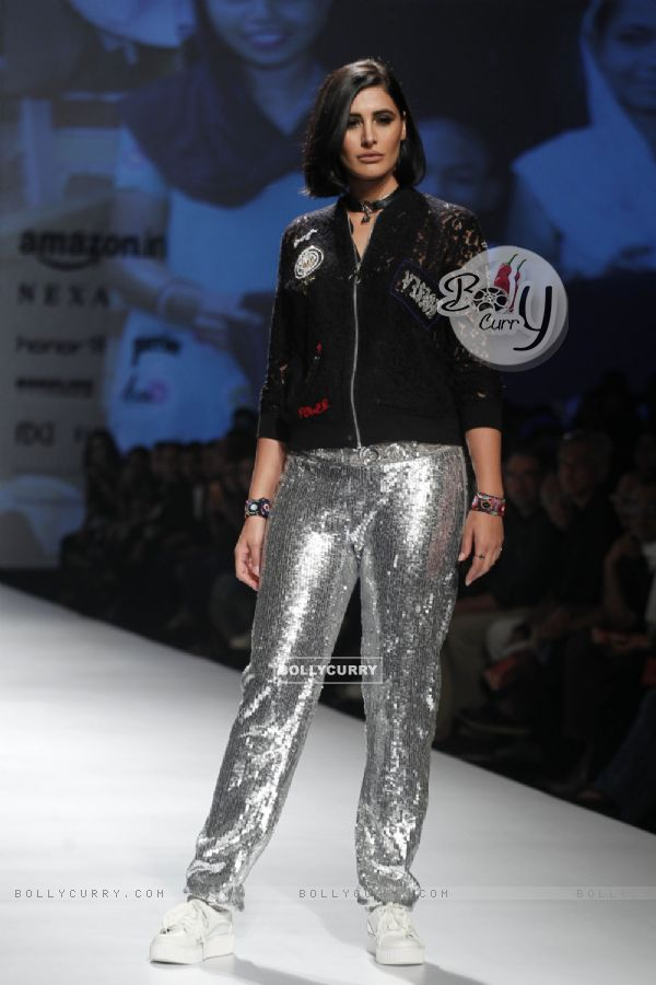 Nargis Fakhri's silver pants are catching our attention