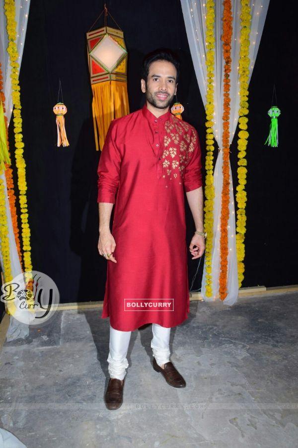 Tusshar Kapoor captured in a striking red kurta
