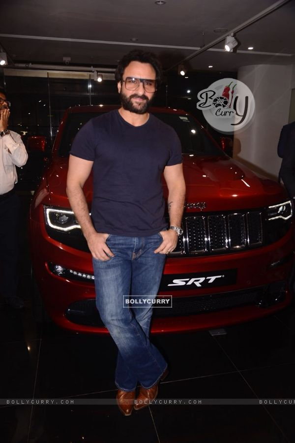 Dressed in casuals, Saif poses with his Jeep