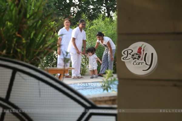 Taimur Ali Khan walking by the poolside