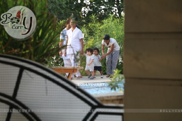 Taimur Ali Khan walking by the poolside