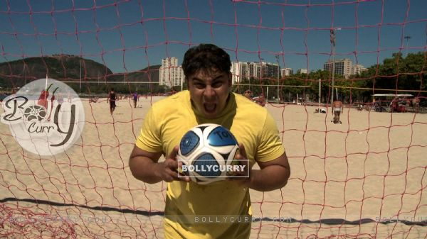 Cyrus Broacha playing football
