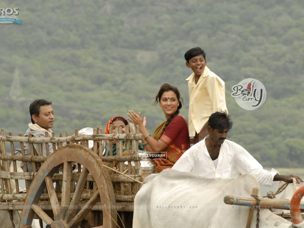 Irfan and Lara sitting on a bullock cart (11139) size:1024x768