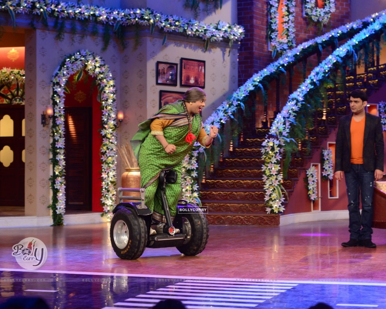 Kiku Sharda does a stunt on segway scooter on CNWK (330304) size:1280x1024