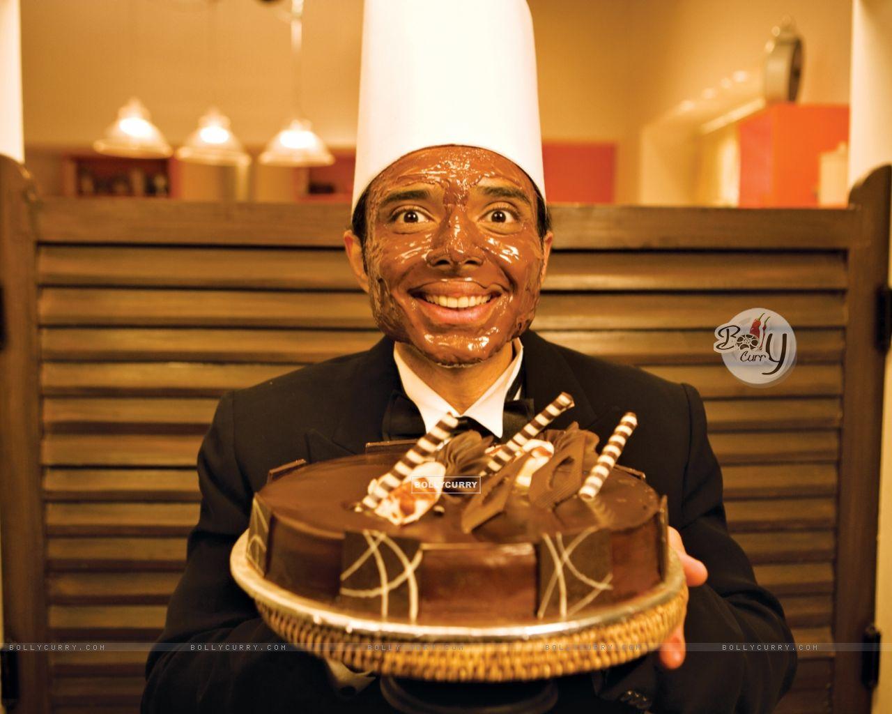 Uday Chopra with Choclate cake (40385) size:1280x1024